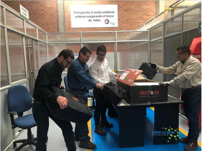 Four men unboxing an Iris MX kit